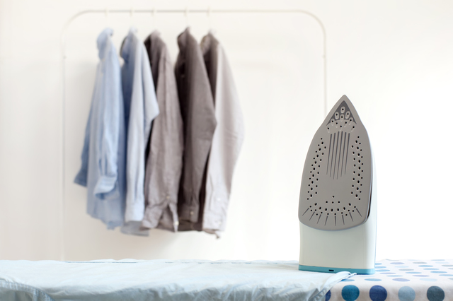 ironing housework ironed folded shirts clean concept still life garment apparel cloth indoors